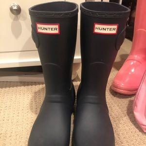 Never worn navy blue Hunter boots